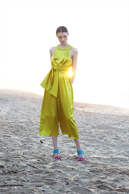 Cynthia Rowley Spring 2016 look 6 featuring a chartreuse silk satin jumpsuit with waist tie