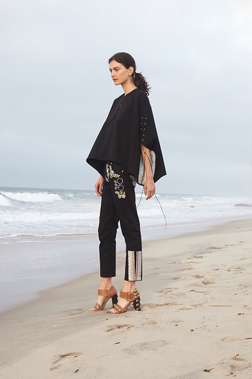 Cynthia Rowley Spring 2016 look 8 featuring black cotton pants and poncho with embroidery