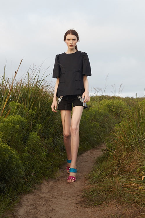 Cynthia Rowley Spring 2016 look 9 featuring black cotton shorts with embroidery and black cotton woven shirt with shirred shoulder and short sleeves