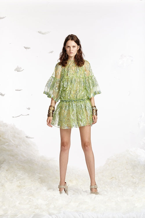 Cynthia Rowley Spring 2017 look 14 featuring a light green sheer metallic lace mini dress with drop waist and elbow length bell sleeves