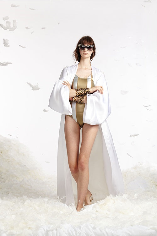 Cynthia Rowley Spring 2017 look 26 featuring a gold and silver striped glideskin one piece swimsuit with long white silk kimono