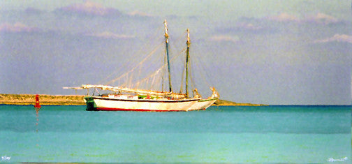 Sailboat anchored in tropical harbor
