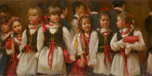 A group of young girls gather for a traditional polish Christmas tradition- the singing of Christmas carols before midnight mass.