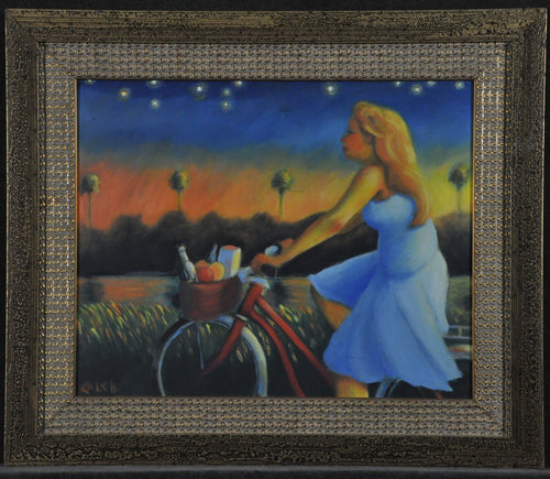 Girl on Bike Picnic starry evening at dusk while sunsets on orange and yellow sky Framed art