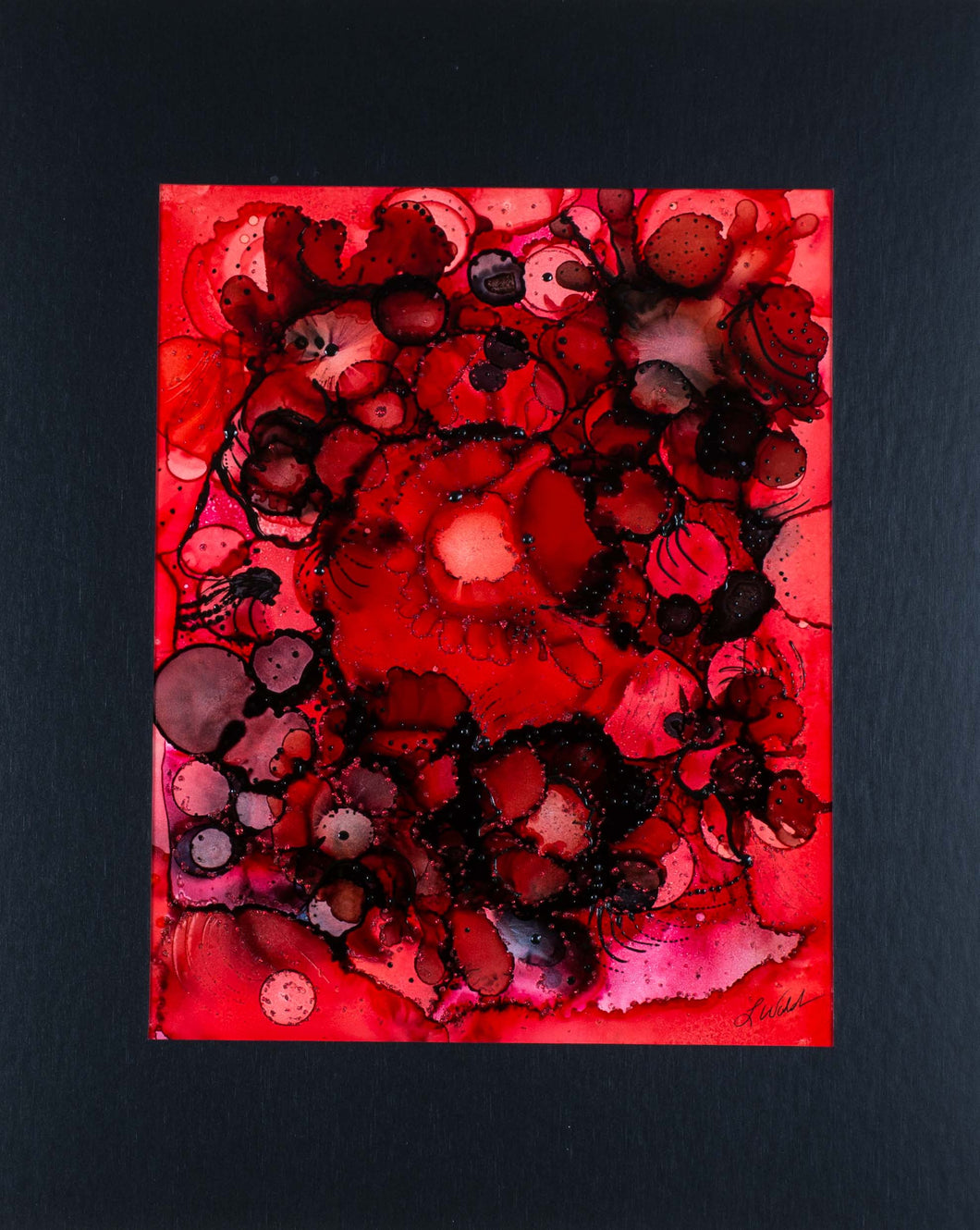 This beautiful alcohol ink is dramatic and deep. Circles of red, and contrasting black spiral around each other, like the powerful emotions of love and anger.