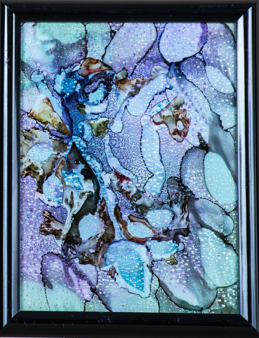 An alkyd abstract purple, blue, and green cavern filled with crystals and water.