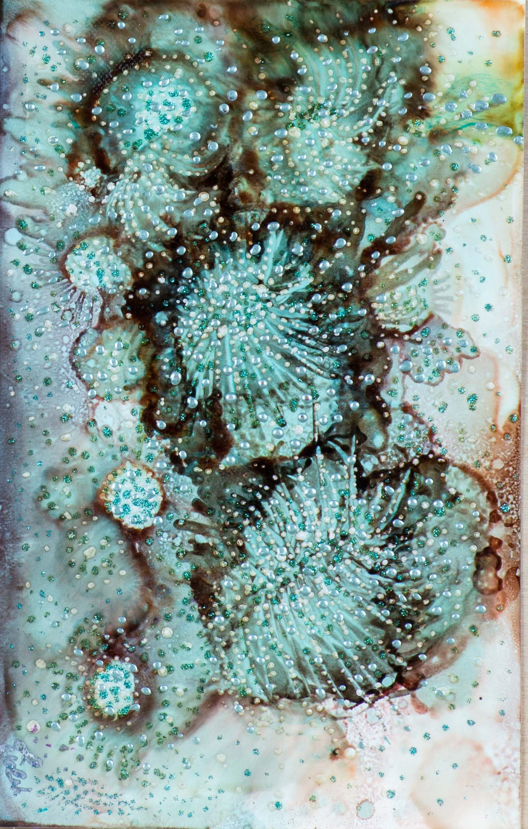 An alcohol ink of marine life with texture and color.