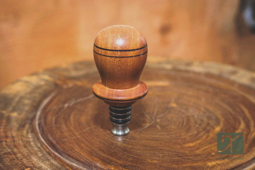 Wine Stopper hand made of Red Wood and metal it is one of a kind