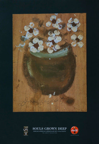 beautiful white and cream flowers sit in a brown African vase for 1980s african american art exhibit event souls grow deep