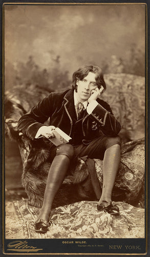 A beautiful sepia photograph of famous author and poet Oscar Wilde. Oscar Wilde had not yet written Dorian Grey when this picture was taken.