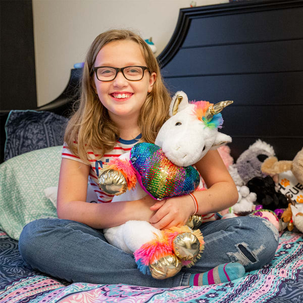 Pictured is Brianna, who loves her comfy bedding and stuffed animals.