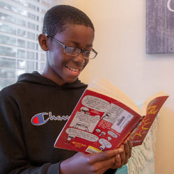 Pictured is Eriyah, who enjoys reading comic books and beginner chapter books.