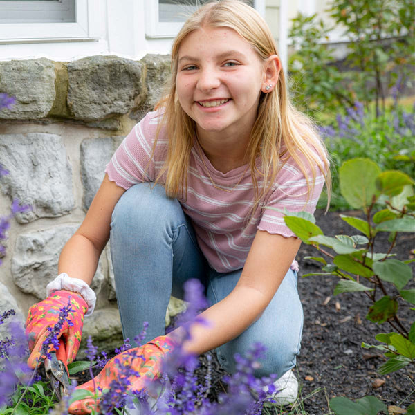 Pictured is Paige, who enjoys gardening with the members of her cottage.