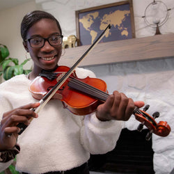 Pictured is Felicia, who plays the violin in the school orchestra.