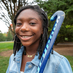 Pictured is Adreanna, who just took up field hockey.