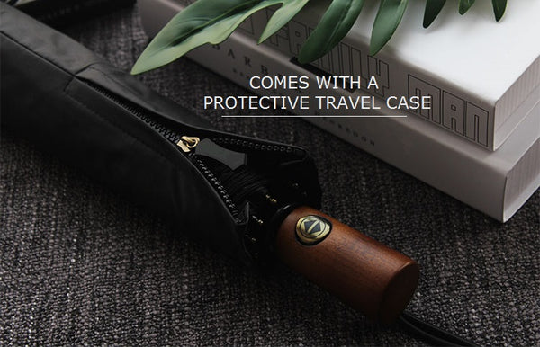 The black wooden handle travel umbrella comes in a travel case with a zipper