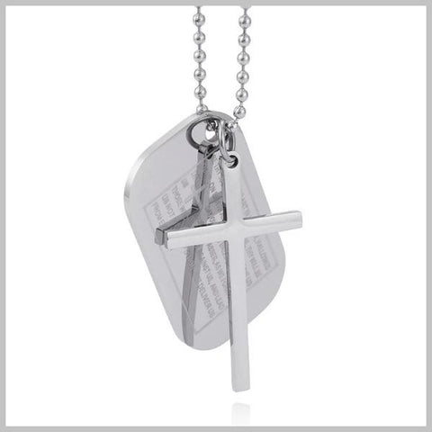 silver cross and plate necklace with the Lord's Prayer on it
