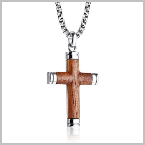 Wooden silver crucifix cross pendant hanging from a silver chain