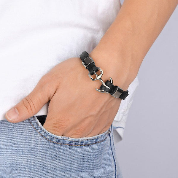 Man wearing a black and silver leather anchor bracelet