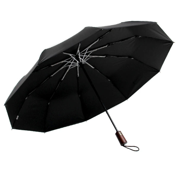 Open black umbrella with a wooden handle and a wrist strap