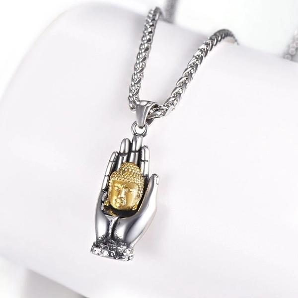 Buddha pendant necklace with gold Buddha head held by a silver hand