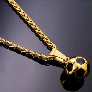 Detailed image of the gold soccer ball pendant and the gold wheat chain necklace