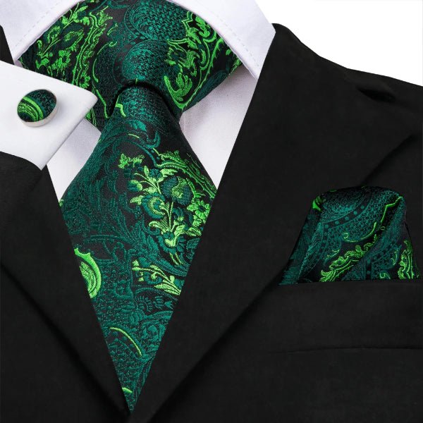 A luxurious green silk floral necktie set on a suit