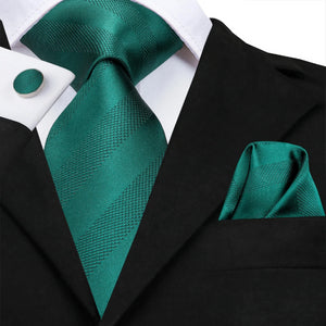 Jade green striped silk tie set on a suit