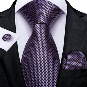 Man wearing a lilac honeycomb pattern silk tie set with matching pocket square and cufflinks