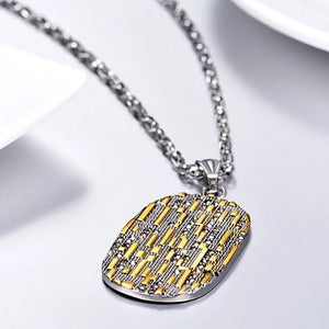 Dog tag pendant with gold lines and black cubic zircons