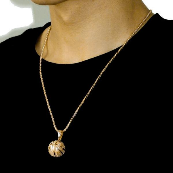 Man wearing a gold basketball pendant necklace with chain