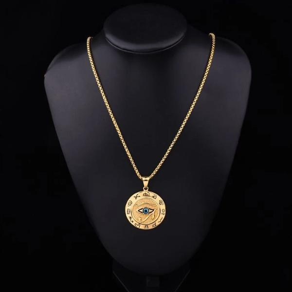 Round gold Eye of Horus pendant hanging on a stainless steel box chain