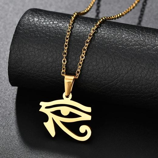 Gold Egyptian eye pendant necklace displayed