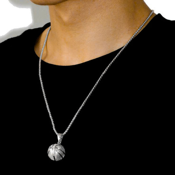 Man wearing a silver basketball pendant necklace with chain