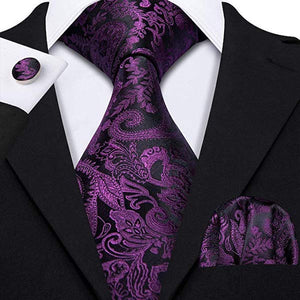 Man wearing a purple and black silk tie set with paisley floral pattern