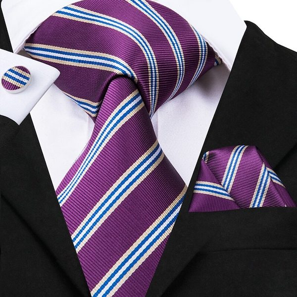 Man wearing a purple striped silk tie set with matching pocket square and cufflinks