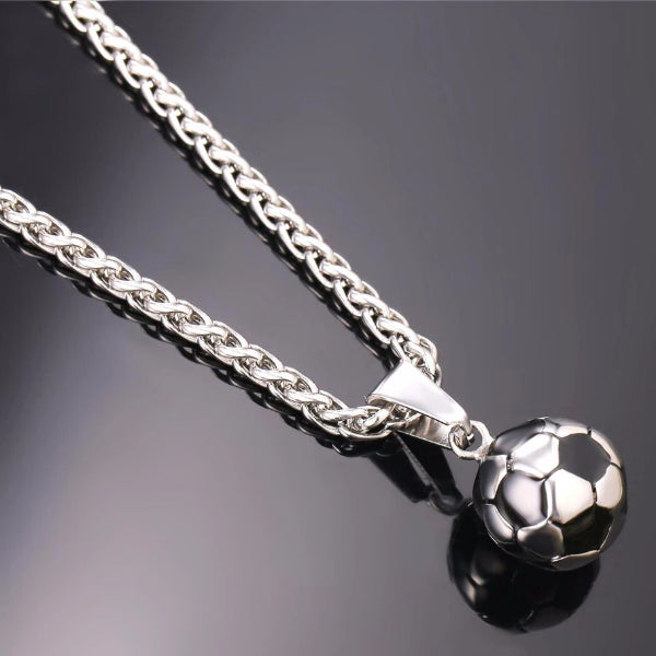 Detailed image of the silver soccer ball pendant and the silver wheat chain necklace