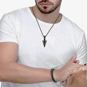 Man Wearing A Black Arrowhead Pendant Necklace