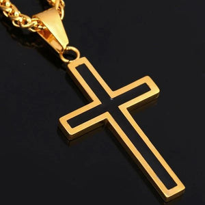 close details of the black and gold cross pendant