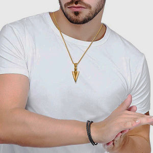 Man Wearing A Gold Arrowhead Pendant Necklace