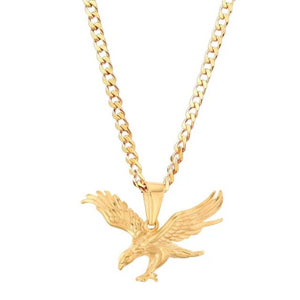 gold eagle pendant hanging from a golden curb chain necklace