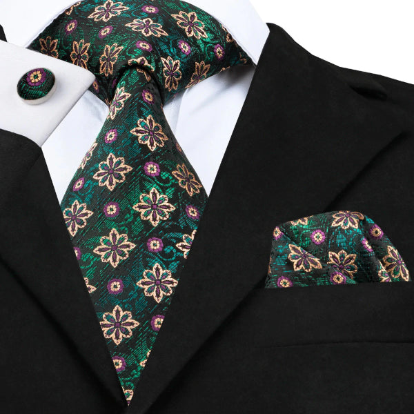 Green & black floral pattern silk tie set on a suit