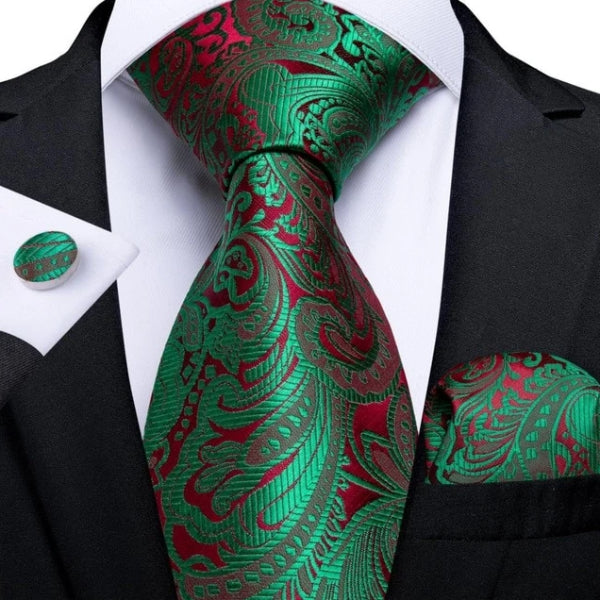 Green & red floral silk necktie set with a matching pocket square and cufflinks on a suit