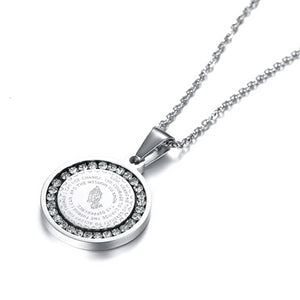The round silver pendant has a CZ halo around the serenity prayer and an image of praying hands