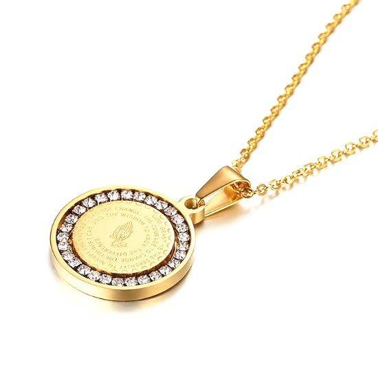 The gold round pendant has a CZ halo around the serenity prayer and an image of praying hands