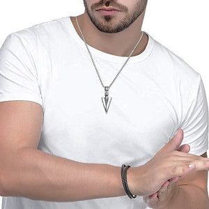 Man wearing a silver arrowhead pendant necklace