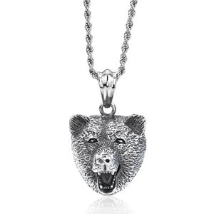 Silver bear head pendant hanging on a necklace