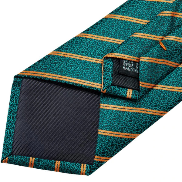 Details of the backside of the teal green & gold striped paisley tie