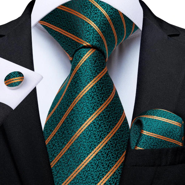 Teal green necktie set with pocket square and cufflinks on a suit