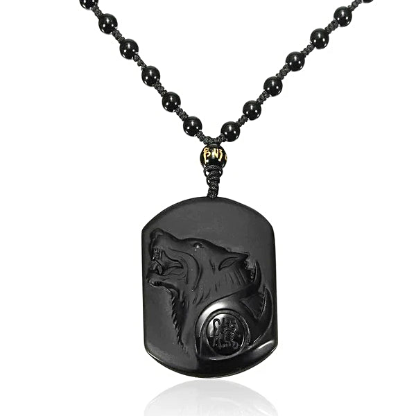 Black wolf charm pendant hanging on a beaded chain necklace